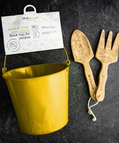 beach toys for children - wooden shovel, rake and a yellow tin bucket